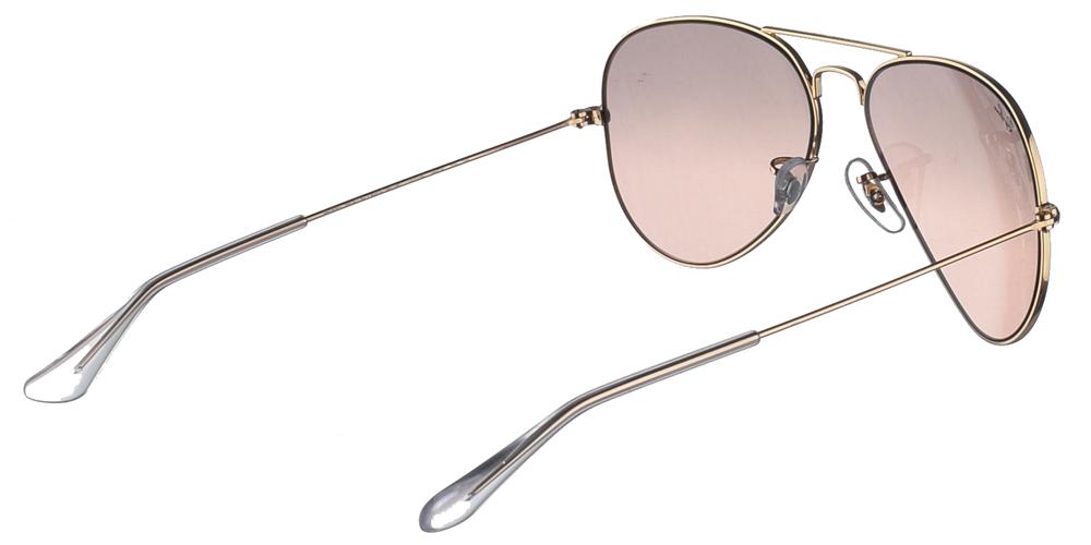Γυναικεία διαχρονικά aviator γυαλιά ηλίου RB 3025 σε χρυσό μεταλλικό σκελετό και απαλούς ροζ κρυστάλλους της εταιρίας Ray Banγια μικρά και μεσαία πρόσωπα.