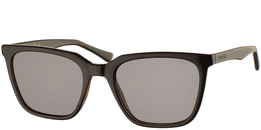 Κοκάλινα ανδρικά και γυναικεία γυαλιά ηλίου Komono Jay Black Tortoise σε σκουρόχρωμη καφέ ταρταρούγα και σκούρους γκρι φακούςγια όλα τα πρόσωπα.