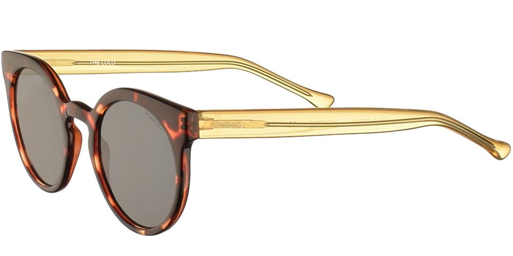 Στρογγυλά γυναικεία κοκάλινα γυαλιά ηλίου Lulu σε καφέ ταρταρούγα και επίπεδους σκούρους γκρι φακούς της εταιρίας Komonoγια μικρά και μεσαία πρόσωπα.