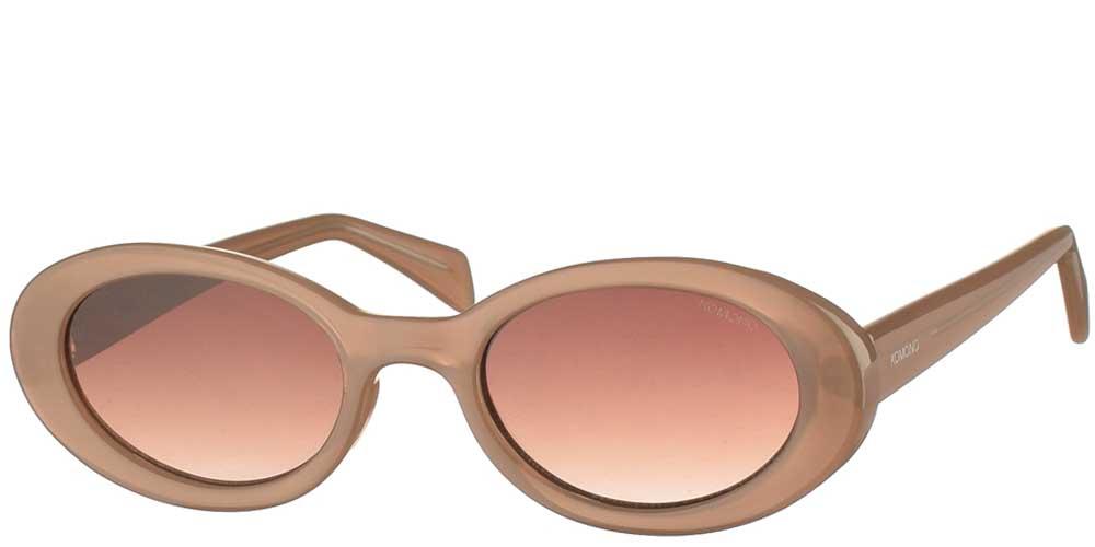 Γυναικεία κοκάλινα γυαλιά ηλίου Ana σε μπεζ σκελετό και καφέ ντεγκραντέ φακούς της εταιρίας Komonoγια μικρά και μεσαία πρόσωπα.