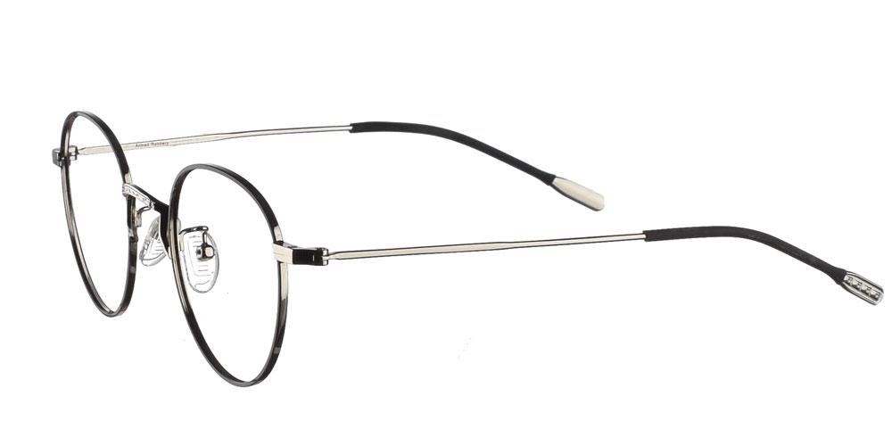 Μεταλλικά ανδρικά και γυναικεία στρογγυλά γυαλιά οράσεως 94's σε μαύρο χρώμα με ασημί λεπτομέρειες της εταιρίας Armed Robbery κατάλληλο για όλα τα πρόσωπα.