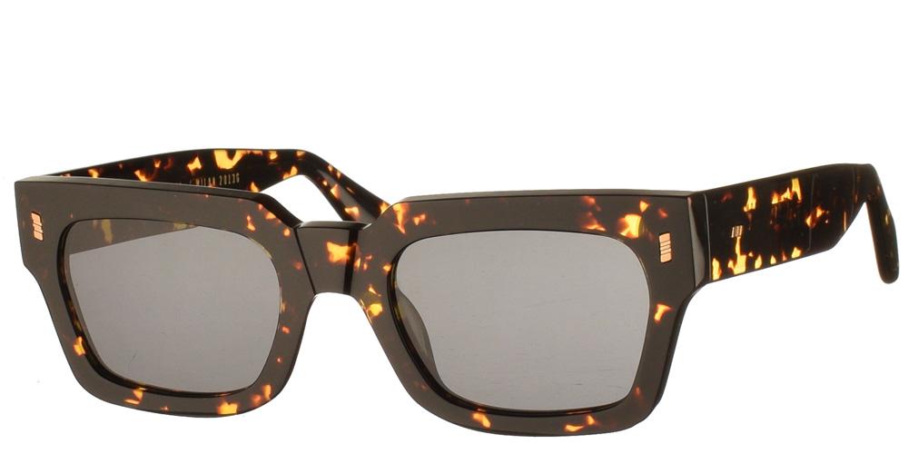 Χειροποίητα τετράγωνα κοκάλινα unisex γυαλιά ηλίου Gotha σε καφέ ταρταρούγα και επίπεδους σκούρους γκρι φακούς με εσωτερικές antireflex επιστρώσεις της εταιρίας Gast κατάλληλα για μεσαία και μεγάλα πρόσωπα.